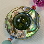 Abalone Saturn composed of Abalone and quartz crystal elements