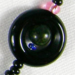 Black Saturn composed of black onyx and malachite elements
